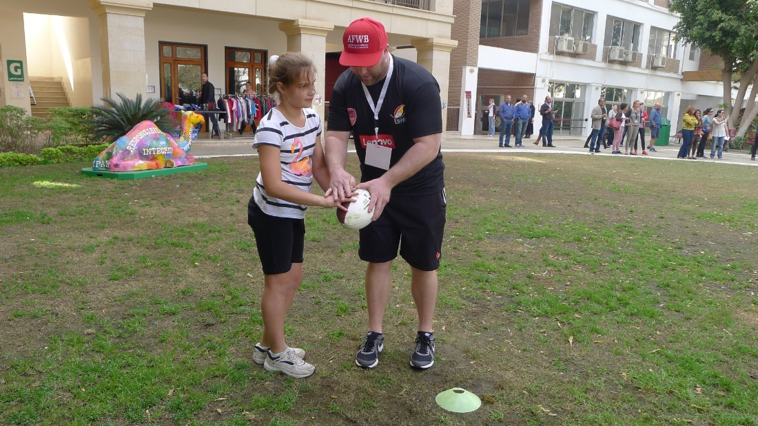 A schoolgirl from the Cairo suburb of Maadi receives coaching at the American Football Without Barriers (AFWB) camp at the Cairo American College.