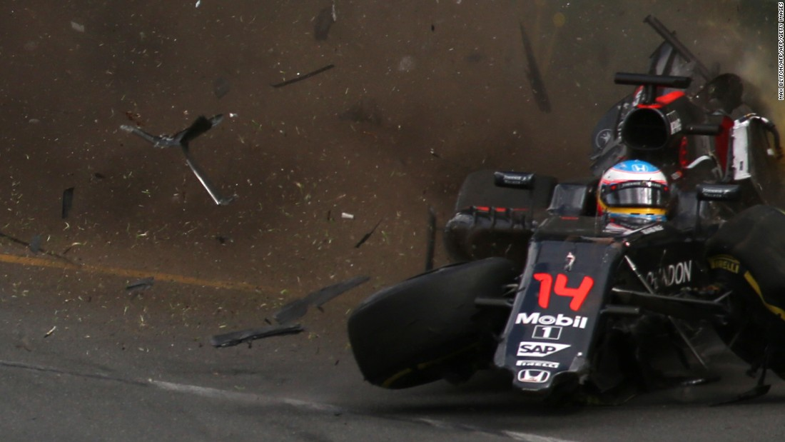 Alonso's car crashed into the wall at 200mph, flipping through the air before coming to rest upside down.