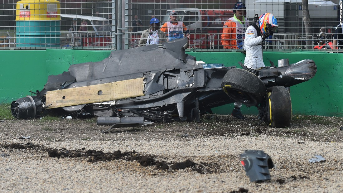 McLaren driver Fernando Alonso walks away from the wreckage of his car after colliding with the Haas of Esteban Gutierrez during the Australian Grand Prix in Melbourne on Sunday.