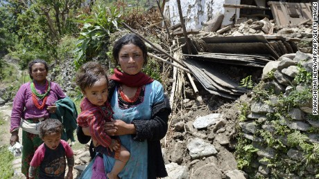 Two women in northeastern Nepal on their way to see doctors, on May 14, 2015, after earthquakes killed over 8,000 people and left hundreds of thousands homeless .
