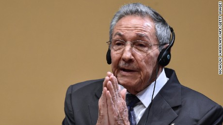 """Cuban President Raul Castro gestures as he delivers a joint press conference with US President Barack Obama (out of frame) after a meeting at the Revolution Palace in Havana on March 21, 2016. Cuba's Communist President Raul Castro on Monday stood next to Barack Obama and hailed his opposition to a long-standing economic """"blockade,"""" but said it would need to end before ties are fully normalized.   AFP PHOTO/Nicholas KAMM / AFP / NICHOLAS KAMM        (Photo credit should read NICHOLAS KAMM/AFP/Getty Images)"""