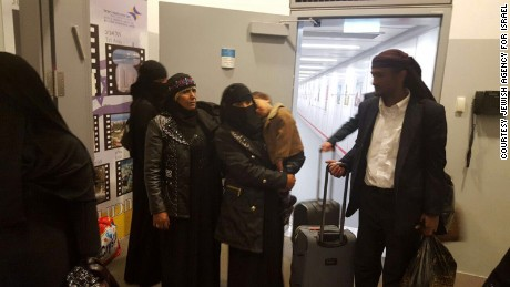 Some member of Yemen's tiny Jewish community, who made a cloaked journey, arrive in Israel.