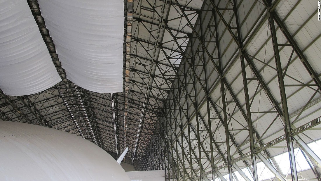 The old hangar is a protected building under English planning laws and was carefully restored to accommodate the Airlander. Those overhead drapes are to catch droppings from birds entering the building.