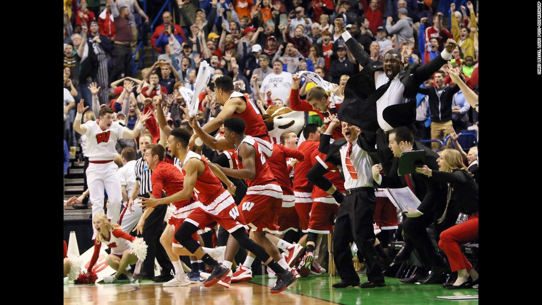 "Wisconsin's bench reacts after Bronson Koenig <a href=""http://bleacherreport.com/articles/2626377-wisconsin-g-bronson-koenig-buries-3-pointer-at-the-buzzer-to-beat-xavier"" target=""_blank"">hit a last-second 3-pointer</a> to defeat Xavier in the second round of the NCAA Tournament on Sunday, March 20. Koenig made six 3-pointers in the game as the Badgers won 66-63."