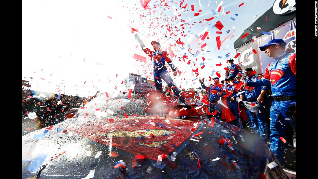 NASCAR driver Jimmie Johnson celebrates on his Superman-themed car after winning the Sprint Cup race in Fontana, California, on Sunday, March 20.