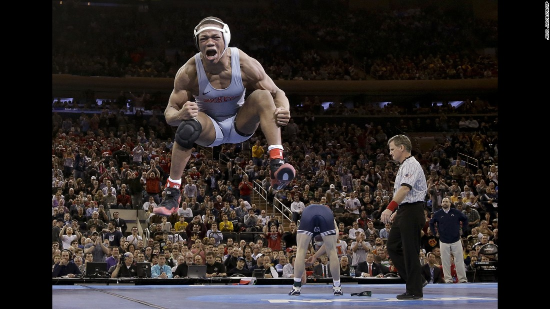 Ohio State wrestler Myles Martin jumps after defeating Penn State's Bo Nickal for the NCAA's 174-pound title on Saturday, March 19.