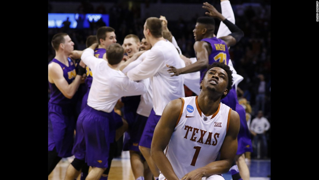 "Texas guard Isaiah Taylor reacts after Northern Iowa's Paul Jesperson <a href=""http://bleacherreport.com/articles/2625951-northern-iowas-paul-jesperson-sinks-half-court-buzzer-beater-to-upset-texas"" target=""_blank"">hit a half-court shot</a> to beat the Longhorns in the first round of the NCAA Tournament on Friday, March 18."
