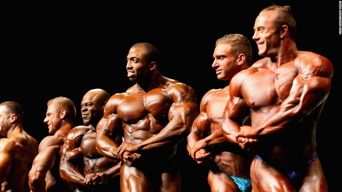 Bodybuilders pose during the Arnold Classic in Melbourne on Saturday, March 19.