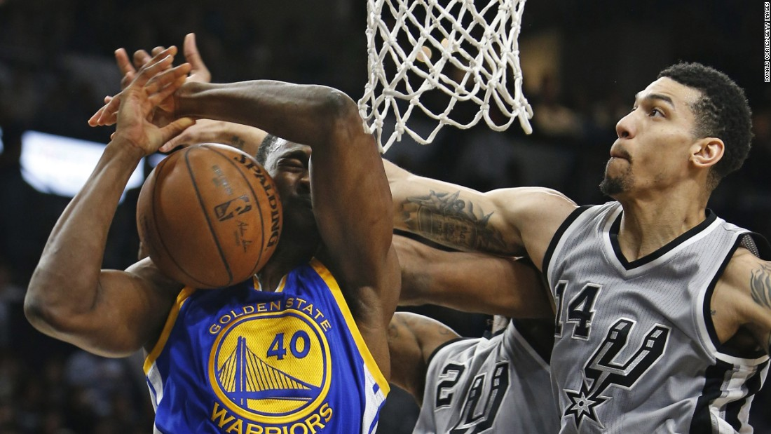 Golden State's Harrison Barnes has his shot blocked by Danny Green, right, and Kawhi Leonard during an NBA game in San Antonio on Saturday, March 19. San Antonio won 87-79 in what was a matchup of the NBA's two best teams. The Warriors have lost only seven games this season. The Spurs have lost 11.