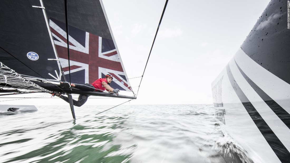 A foiling catamaran is skippered by Bleddyn Mon during an Extreme Sailing Series race in Muscat, Oman, on Friday, March 18.