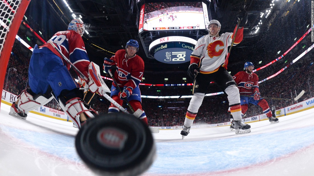 Calgary's Joe Colborne raises his stick after scoring a goal during an NHL game in Montreal on Sunday, March 20.