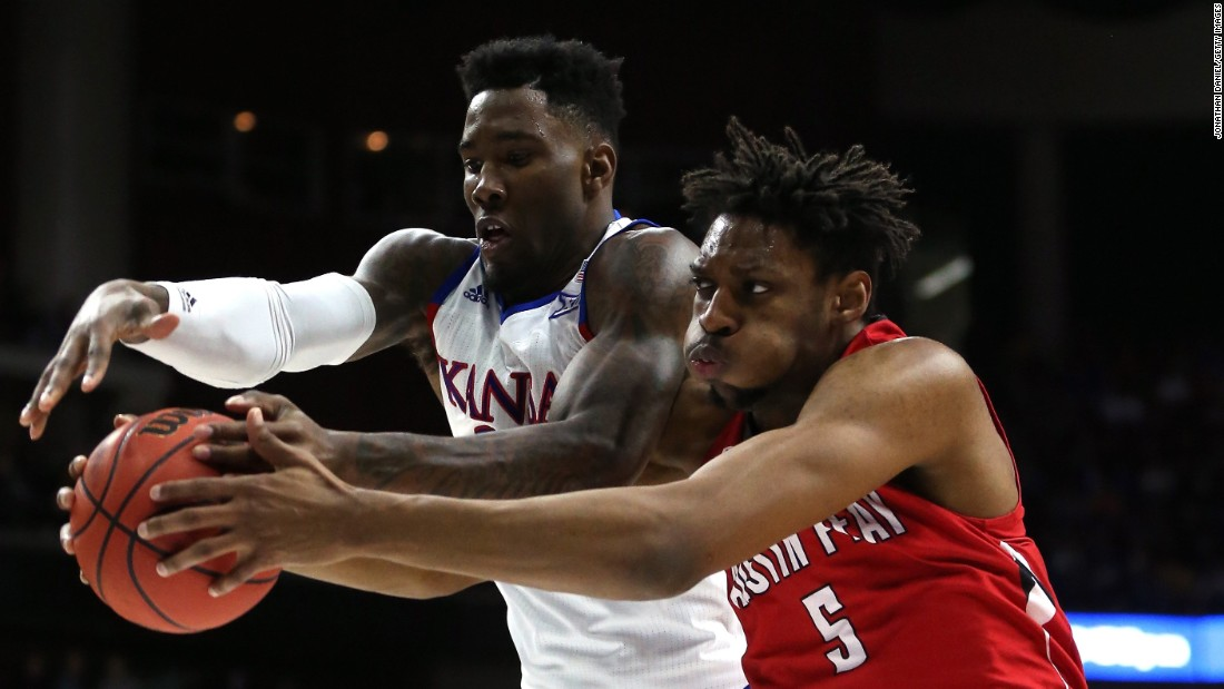 Kansas' Jamari Traylor and Austin Peay's Chris Horton reach for a rebound during an NCAA Tournament game on Thursday, March 17. Kansas, the tournament's top seed, rolled to the second round with a 105-79 victory.