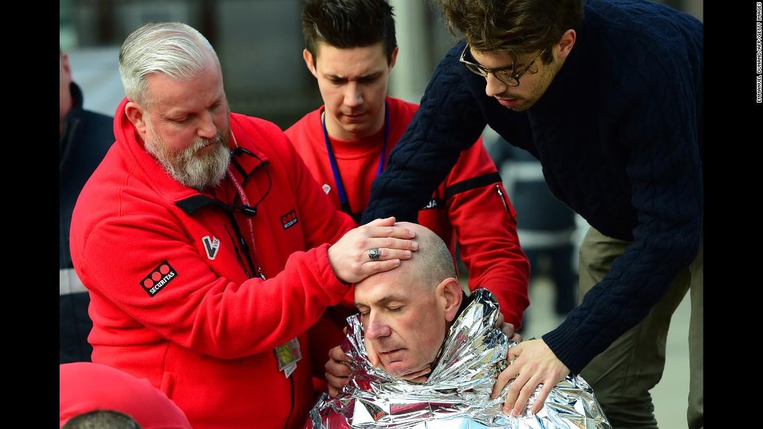 A victim receives first aid near the Maelbeek metro station.