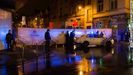 Belgian police cordon off a street during a police raid in connection with the November 13 deadly attacks in Paris, in Brussels' Molenbeek district on November 14, 2015.