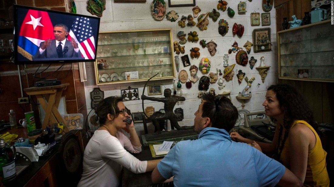 Tourists in a Havana antique shop watch Obama give a speech on March 22.
