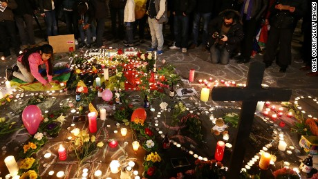 People light candles at the Place de la Bourse following today's attacks on March 22, 2016 in Brussels, Belgium.