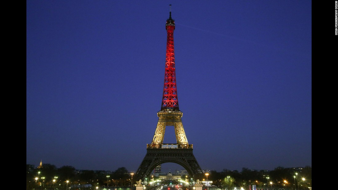 The Eiffel Tower is lit up with the colors of the Belgian flag on March 22.