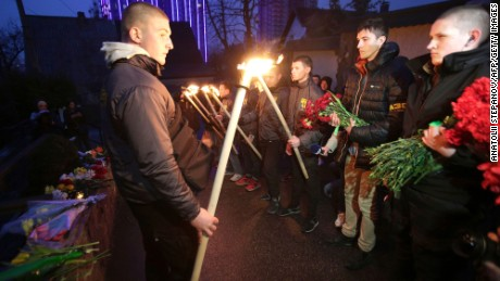 Servicemen of Azov, a Ukrainian volunteer battalion, hold torches during a tribute ceremony at the Belgian embassy in Kiev on March 22.
