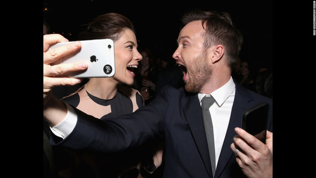 "Actors Aaron Paul and Michelle Monaghan take a selfie at the Hollywood premiere of ""The Path"" on Monday, March 21."