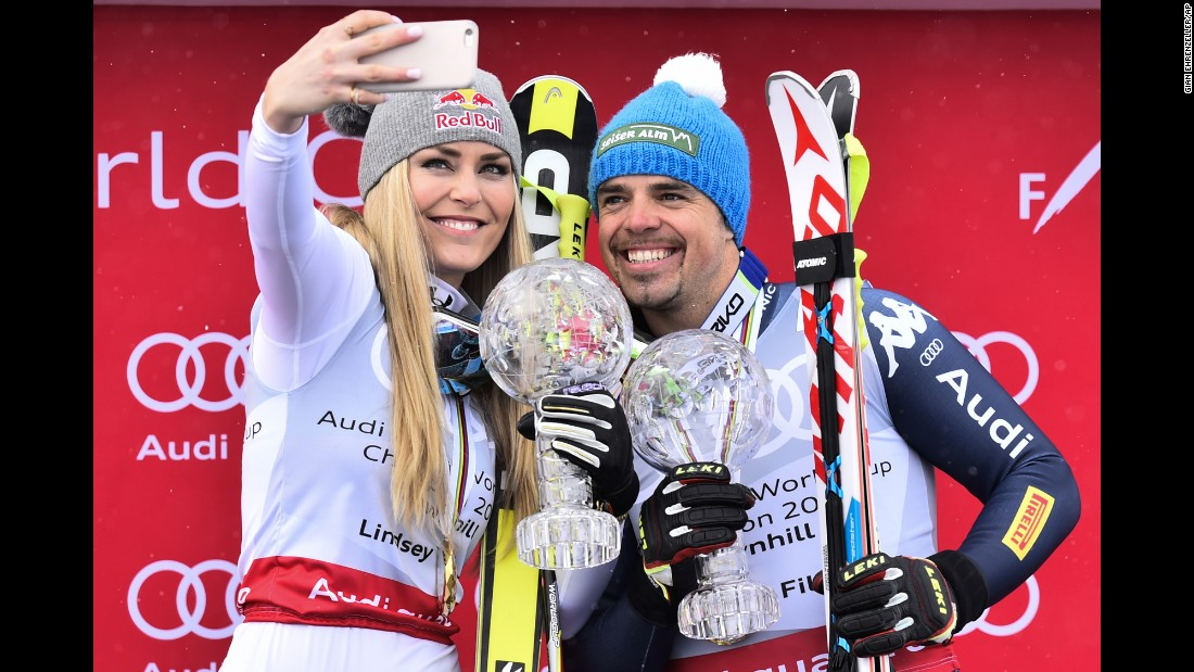 Skiers Lindsey Vonn and Peter Fill hold their World Cup downhill trophies on Wednesday, March 16. Vonn, an American, has won eight downhill titles in her career. It was the first World Cup title for Fill, an Italian.