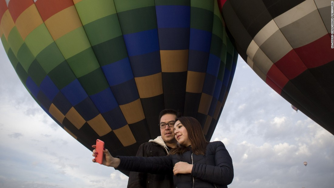 People take a selfie in San Martin de las Piramides, a Mexican town hosting the National Meeting of Hot Air Balloons on Sunday, March 20.