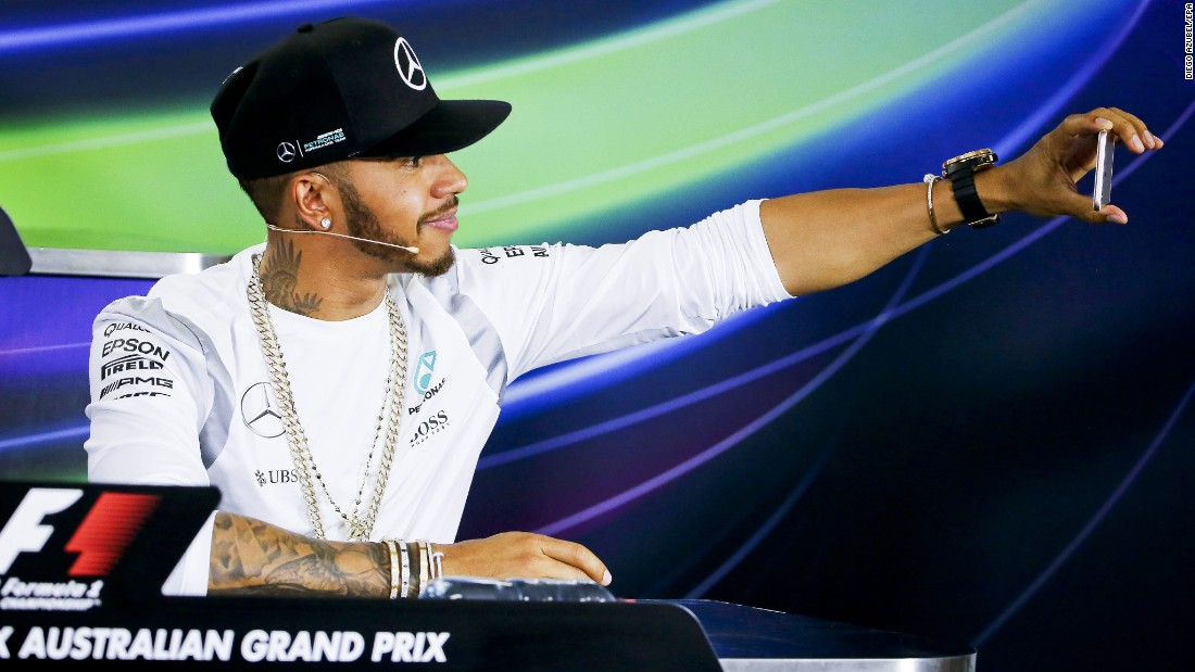 Formula One champion Lewis Hamilton snaps a selfie during a news conference for the Australian Grand Prix on Thursday, March 17.
