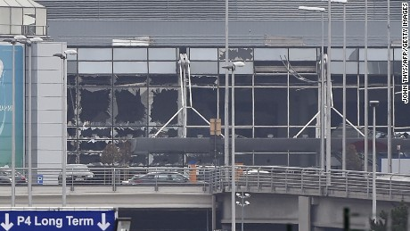 A picture taken on March 22, 2016 in Zaventem, shows the damaged facade of Brussels airport after at least 13 people were killed and 35 injured as twin blasts rocked the main terminal of Brussels airport.AFP PHOTO / JOHN THYS / AFP / JOHN THYS        (Photo credit should read JOHN THYS/AFP/Getty Images)