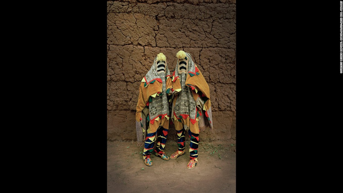 """Untitled"", Leonce Raphael Agbodjélou (2011). This work is part of the portrait series ""Vodou."" The artist, a photographer from Benin, has used brightly colored costumes traditionally used by masqueraders at Yoruba funerals."