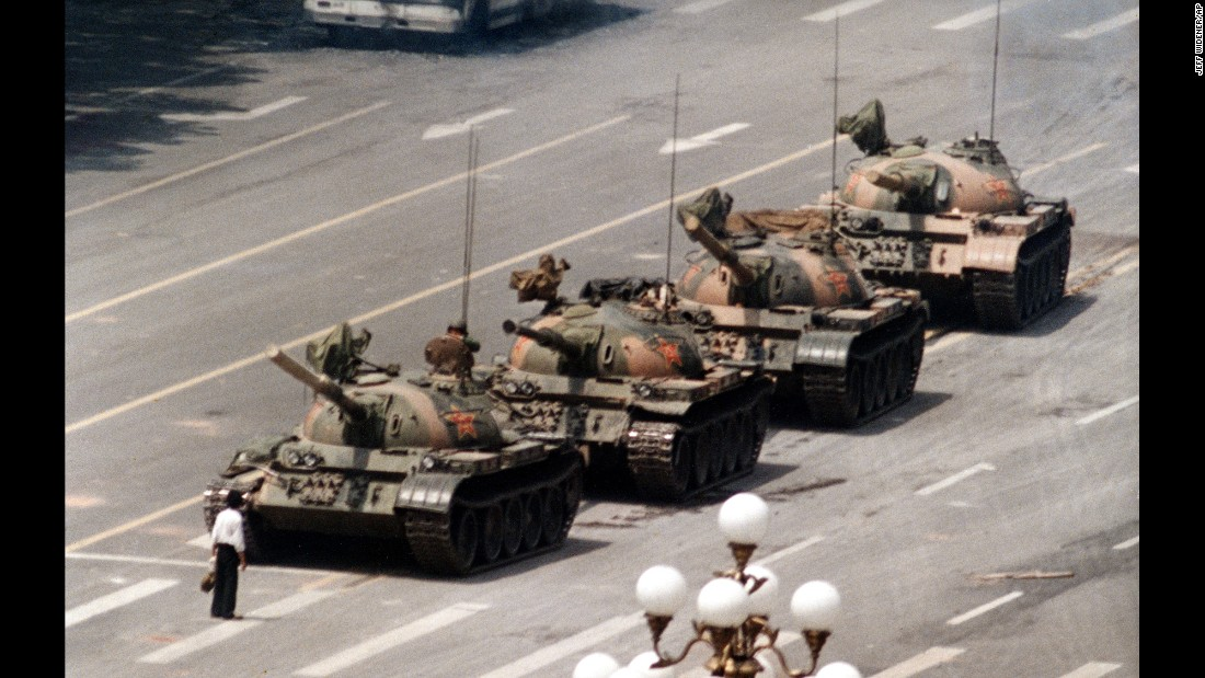"<strong>Tiananmen massacre: </strong>In this iconic photo from Beijing's Tiananmen Square, an unidentified man stands alone on Cangan Boulevard, blocking the advance of military tanks on June 5, 1989. Anywhere from hundreds to thousands of people died the day before when Chinese <a href=""http://www.cnn.com/2013/09/15/world/asia/tiananmen-square-fast-facts/"" target=""_blank"">troops fired on civilians</a> who were participating in peaceful anti-government protests in the square. The demonstrations, initiated by students seeking democratic reform and an end to government corruption, also led to thousands of arrests and several dozen executions. Tiananmen, ironically, means ""Gate of Heavenly Peace."""