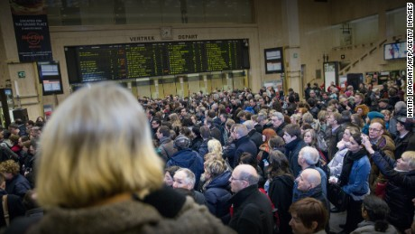 People wait for their train at Brussels' central station, on March 23 2016, one day after the attacks on Brussels airport and at a metro station. About 20 people were killed on the metro and 14 at the airport in the rush-hour assaults, which came just days after the arrest in Brussels of the main fugitive suspect in November's gun and bomb rampage in Paris. / AFP / BELGA / HATIM KAGHAT / Belgium OUT (Photo credit should read HATIM KAGHAT/AFP/Getty Images)
