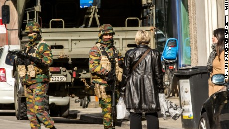 "Women speak to soldiers as they block the access to road close to Maalbeek - Maelbeek metro station in Brussels on March 22, 2016 after a series of apparently coordinated explosions ripped through Brussels airport and a metro train, killing at least 14 people in the airport and 20 people in the metro in the latest attacks to target Europe. Security was tightened across the jittery continent and transport links paralysed after the bombings that Belgian Prime Minister Charles Michel branded ""blind, violent and cowardly"". / AFP / PHILIPPE HUGUEN        (Photo credit should read PHILIPPE HUGUEN/AFP/Getty Images)"