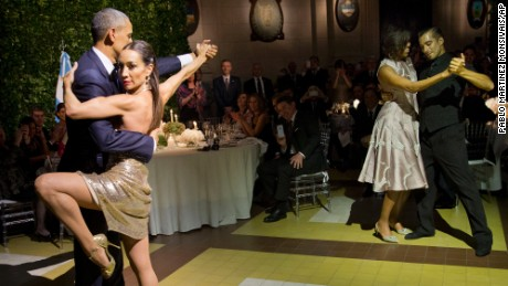 President Barack Obama and first lady Michelle Obama dance the tango with tango dancers during the State Dinner at the Centro Cultural Kirchner, Wednesday, March 23, 2016, in Buenos Aires, Argentina.
