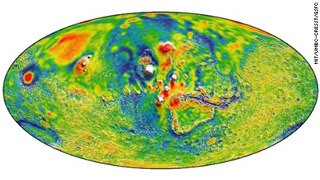 Gravity map of Mars shows Tharsis volcanoes. White and red are areas of higher gravity; blue lower.
