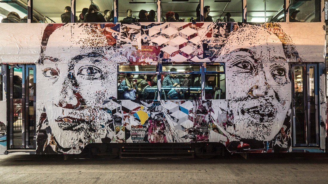 Vhils plastered a moving tram, a century-old form of transport in Hong Kong, with his signature work. The portraits on the facade are based on anonymous residents of the city.