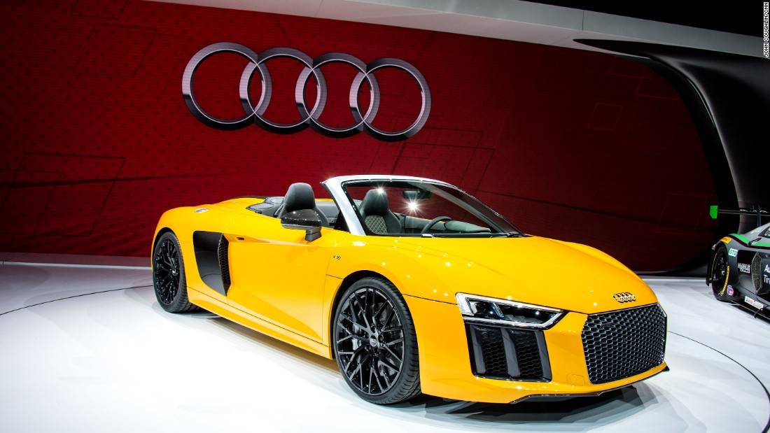 "Debuting in striking yellow, the new <a href=""https://www.audiusa.com/"" target=""_blank"">Audi</a> R8 Spyder has a 540-horsepower V10 engine capable of launching this car to 60 mph in just 3.6 seconds.<br /><br />It has Audi's new virtual cockpit. The entire gauge cluster area is a big computer screen that can also show, say, navigation maps right in front of the driver.<br /><br />You can also opt for Audi's signature laser lighting system which provides extra bright lighting at night."