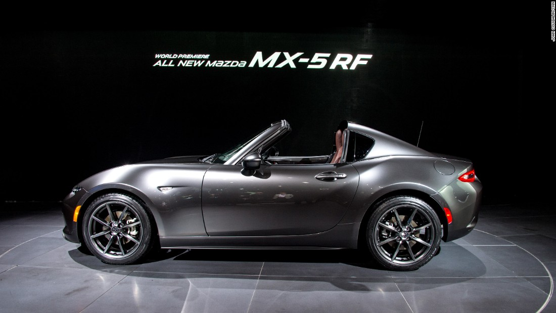 "The recently redesigned <a href=""http://www.mazda.com"" target=""_blank"">Mazda</a> Miata is a nice-looking sports car. It looks even better with a roof on it. The mid-section of the MX-5 RF's hardtop can fold away in about 12 seconds, leaving behind a Targa-style open roof."