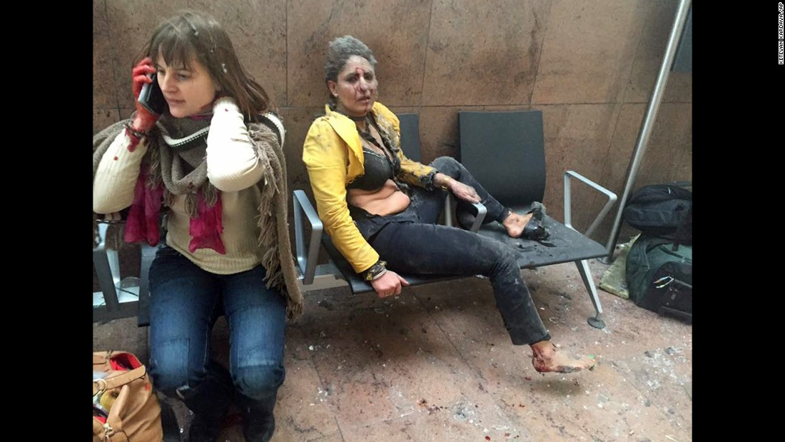 "Two wounded women sit in the airport in Brussels, Belgium, after two explosions rocked the facility on Tuesday, March 22. A subway station in the city <a href=""http://www.cnn.com/2016/03/24/europe/brussels-investigation/index.html"" target=""_blank"">was also targeted in terrorist attacks</a> that killed at least 35 people and injured hundreds more."