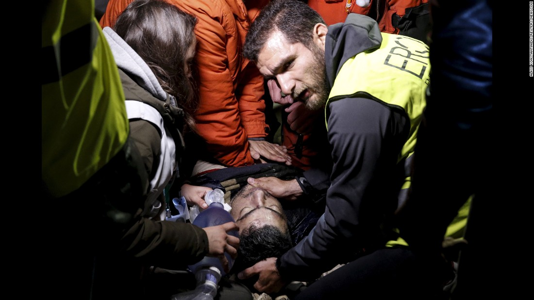 "Rescuers on the Greek island of Lesbos try to revive an unconscious man who arrived on a dinghy with other migrants on Sunday, March 20. Hospital authorities later said the man, a Syrian, didn't survive. <a href=""http://www.cnn.com/2015/09/03/world/gallery/europes-refugee-crisis/index.html"" target=""_blank"">Europe's migration crisis in 25 photos</a>"