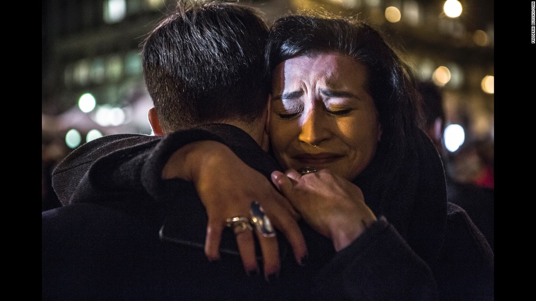 "On Wednesday, March 23, a day after the deadly bombings in Brussels, a vigil was held at the Place de la Bourse in the Belgian capital. ""Everybody should come together and stay positive,"" said 28-year-old Anne Manteleers, right. <a href=""http://www.cnn.com/interactive/2016/03/world/faces-of-fear-brussels/"" target=""_blank"">Interactive: Faces of fear and hope in Brussels</a>"