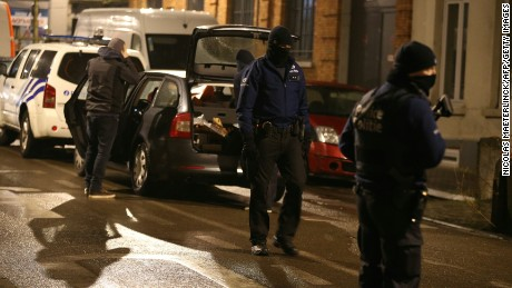Police officers take part in an operation in Brussels, late on March 24, 2016, two days after jihadist attacks in Brussels.