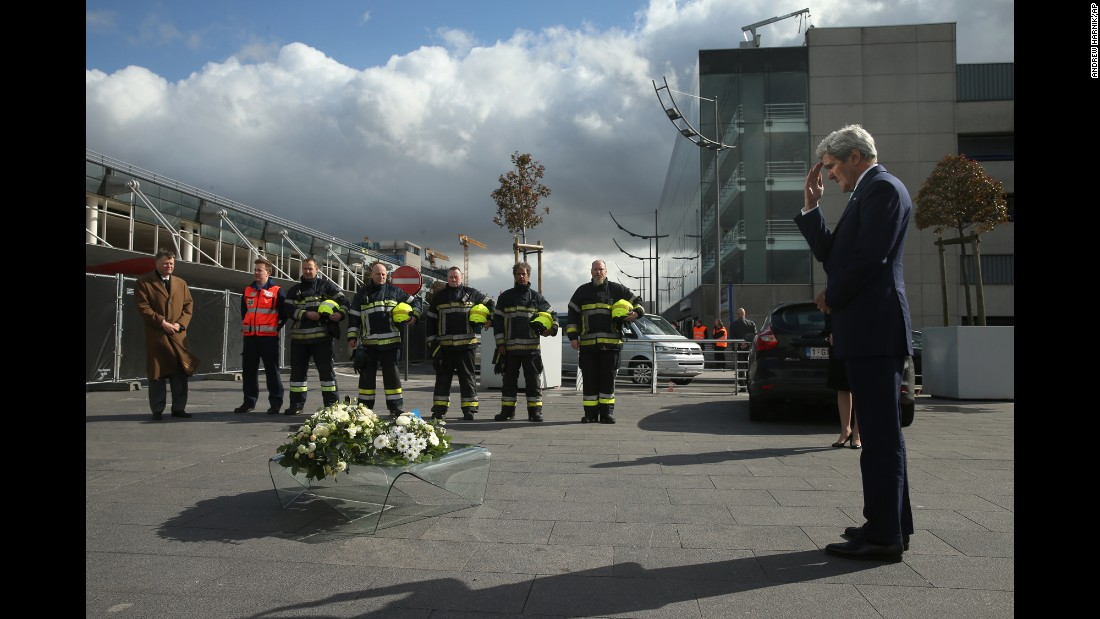 Secretary of State John Kerry participates in wreath-laying ceremony at Brussels Airport in Brussels, Belgium, on Friday, March 25. Kerry paid his respects to victims of terrorist attacks that left more than 30 dead at Brussels Airport.