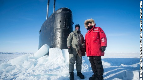 160318-N-QA919-432 Arctic Circle (March 15, 2016) - Lt. Gen. Russell J. Handy, Commander, Alaskan Command, stands with Cmdr. Thomas Aydt, Commanding Officer of Los Angeles-class submarine USS Hartford (SSN-768) during Ice Exercise (ICEX) 2016. ICEX 2016 is a five-week exercise designed to research, test, and evaluate operational capabilities in the region. ICEX 2016 allows the U.S. Navy to assess operational readiness in the Arctic, increase experience in the region, advance understanding of the Arctic Environment, and develop partnerships and collaborative efforts. (U.S. Navy photo by Aerographer's Mate 2nd Class Zachary Yanez)