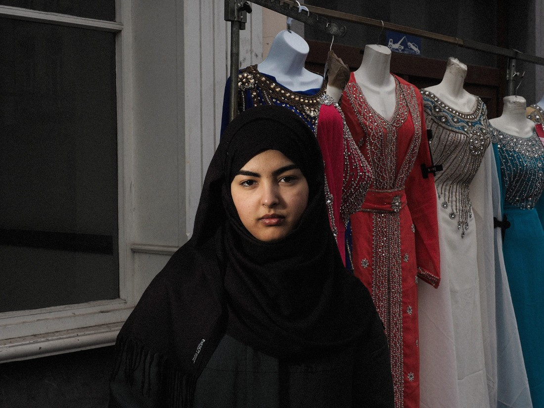 "Nohaila, 21, was born and raised in Molenbeek. ""Yesterday I was in the Place de la Bourse (where people gathered to mourn the victims) and a man spat on my foot. He said, 'Get out! Everything that has happened is because of you Muslims.'"""