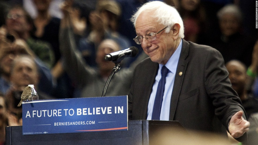A bird shares the lectern with Democratic presidential candidate Bernie Sanders as he speaks on Friday, March 25, in Portland, Oregon. Sanders spoke to a crowd of more than 11,000.