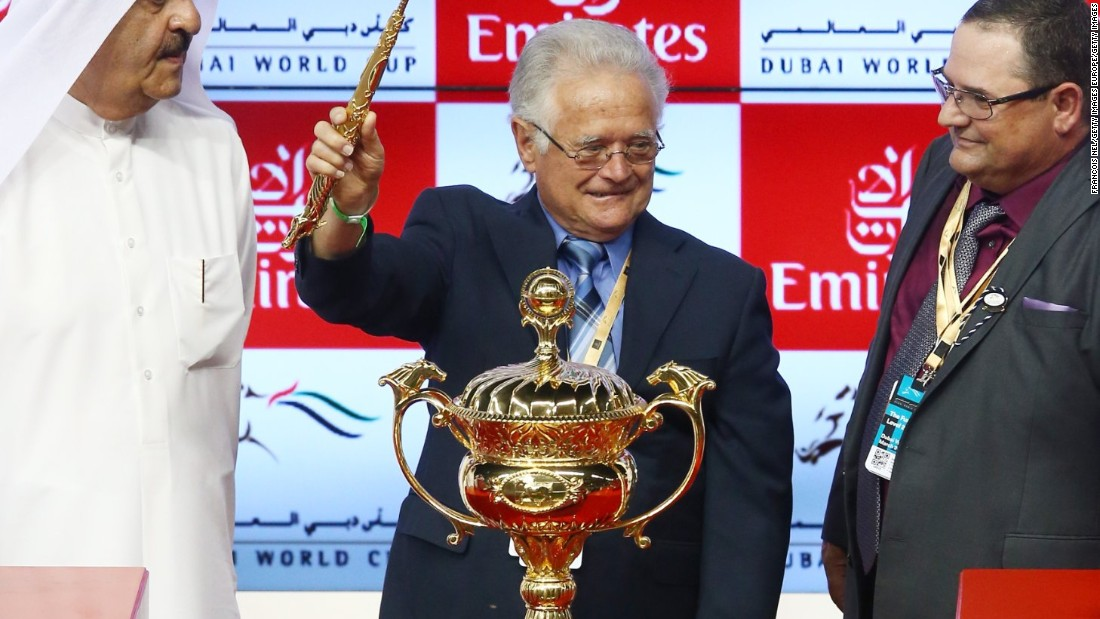 Art Sherman, the legendary trainer of California Chrome, celebrates with the trophy after victory in the Dubai World Cup.