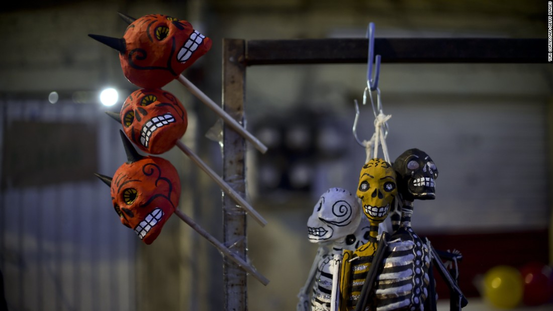 Colorful skull figures are displayed for sale during Holy Week celebrations in Mexico City.