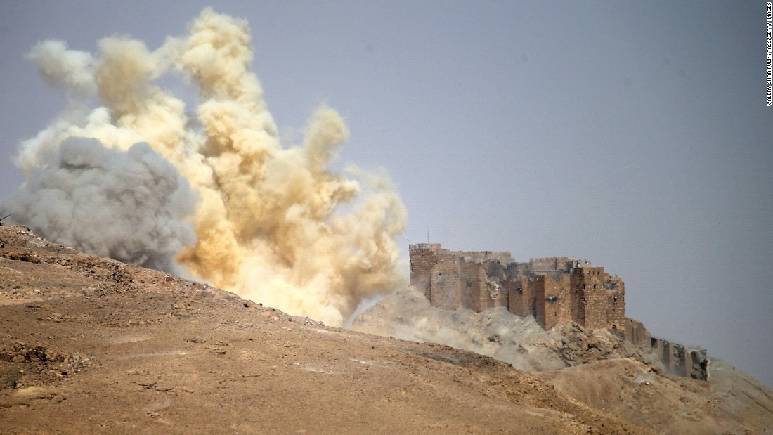 A dust cloud rises near the Palmyra Castle during the military operation to retake Palmyra on March 25.