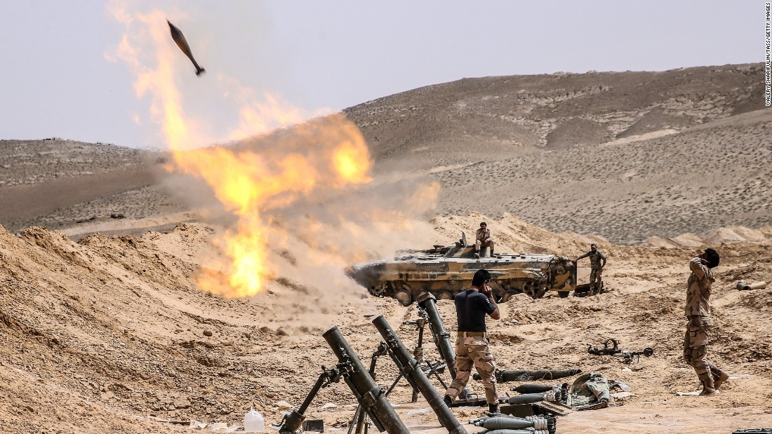 Syrian soldiers fire mortars at ISIS positions in Palmyra on March 25.