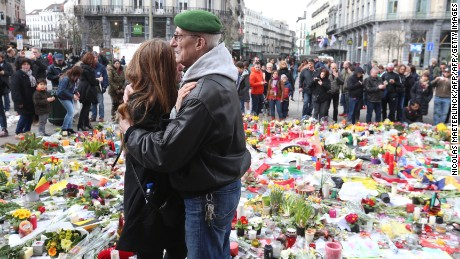People gather on the on the Place de la Bourse (Beursplein) in central Brussels, on March 27, 2016, tribute to the victims of the coordinated terror attacks in the city claimed by the Islamic state group (IS) on March 22, in which 31 people were killed and over 300 injured. Belgians gathered on March 27 in solidarity and defiance in central Brussels to remember victims of the country's worst-ever terror attacks as prosecutors charged a second man over a foiled attack in France.  / AFP / Belga / NICOLAS MAETERLINCK / Belgium OUT        (Photo credit should read NICOLAS MAETERLINCK/AFP/Getty Images)