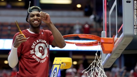 Buddy Hield smiles after cutting a piece of the net after the No. 2 Oklahoma Sooners advanced to the Final Four with an 80-68 victory against the No. 1 Oregon Ducks on Saturday in Anaheim, California.